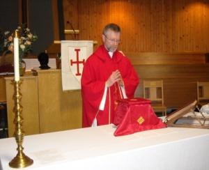 Father Jim celebrating the Holy Eucharist
