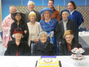 Group picture with Jubilee cake