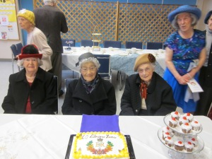 Group picture around Jubilee cake